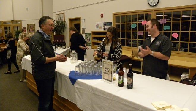 Visitors enjoy a sampling at the Stayton Public Library Foundation's Brews, Bites & Books fundraiser.