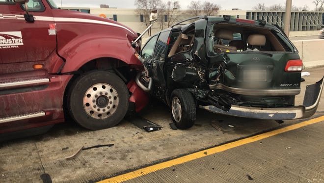 A crash officials say involved three semi-trucks and two cars closed southbound I-465 Sunday evening. One child and four adults were taken to the hospital. License plates have been blurred by Wayne Township Fire Department.