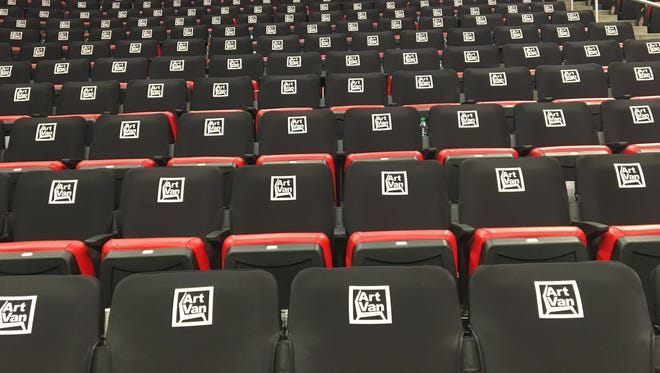 The new seat covers for Detroit Pistons games at Little Caesars Arena sponsored by Art Van Furniture.