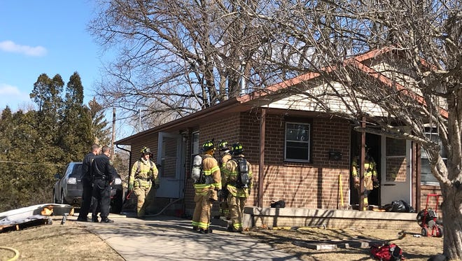 Firefighters clear out a first-floor blaze Tuesday, March 13, 2018.