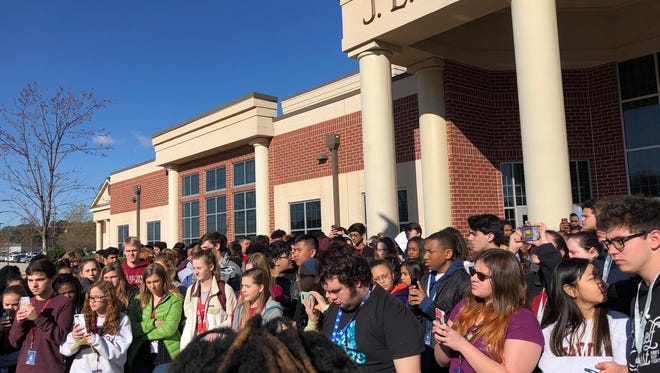 More than 200 students left class at J.L. Mann for Wednesday's National School Walkout and face citations for cutting class, according to Greenville County Schools.