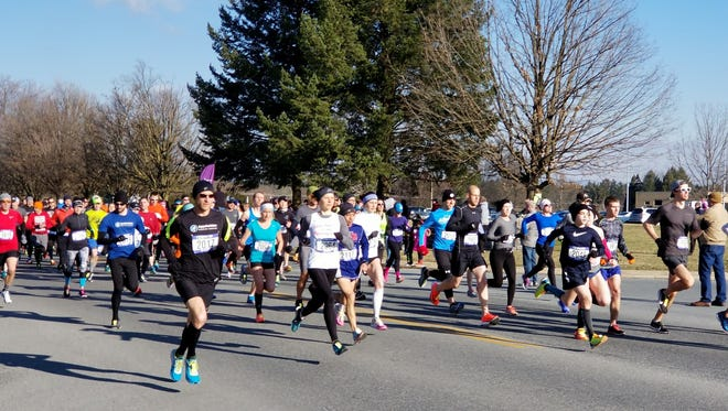 Runners take off for the start of last weekend's Chambersburg Half Marathon.