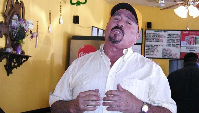 Felix Ortega sings mariachi for customers at El Jardin Mexican Restaurant.