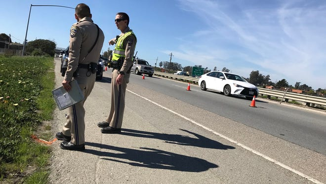 California Highway Patrol officers investigate a major-injury crash on southbound Highway 101 just north of the Market Street exit Thursday afternoon.