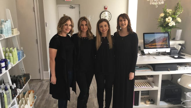 Stacey Trinkle, from left, owner Tonya DeRose, Kaitlyn Mullins and Taylor Otterbacher work at Amity salon in downtown Clarksville.