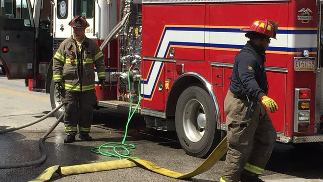 Firefighters clean up after fighting a fire in the 600 block of Wallace Street in York.