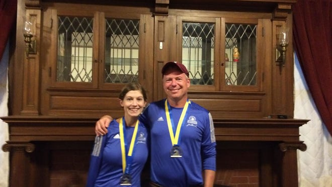 Laura and Jack McDermott with their medals following Monday's Boston Marathon.