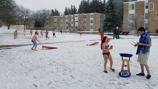 Ripon College students grill out and a winter beach party Saturday, April 14.