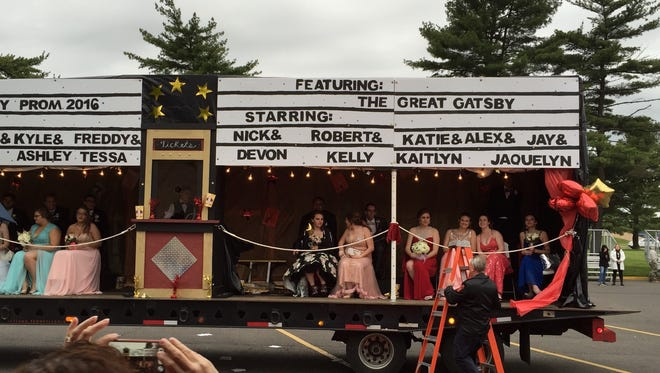 Students arrive to Pennsbury High School prom on a movie-themed float.