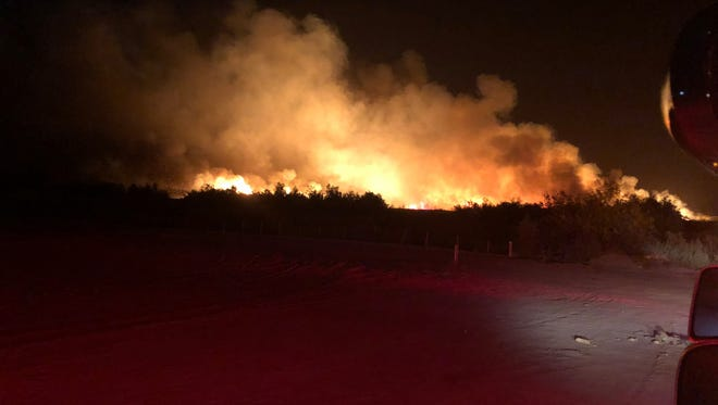 A wildfire that broke out near Avenue 68 and Fillmore Street in Thermal Friday night was 50 percent contained by Saturday morning, April 28, 2018, Cal Fire officials said.
