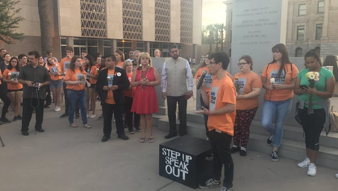 The vigil has begun Phoenix March for Out Lives co-chair Jordan Harb saying clergy will pray for the group before a description of #SantaFeHigh victims is given and ten minutes of silence on May 21, 2018.