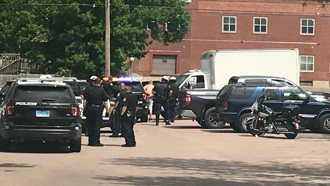 Police activity near the intersection of East 8th Street and South Indiana Avenue on Wednesday as two people are arrested.