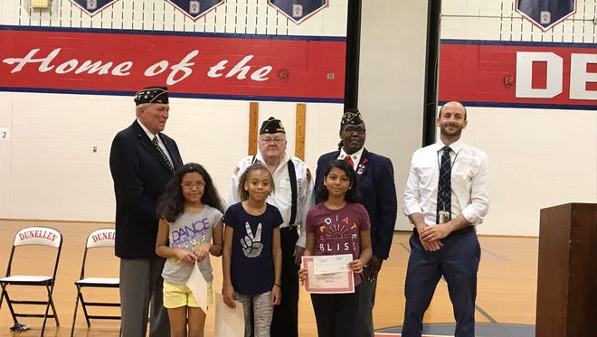 \Winners of the essay contest with members of the American Legion and Gary Lubisco, Jr. principal.
