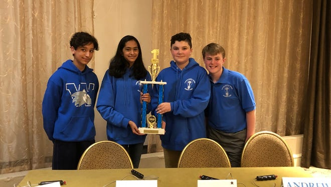 (left to right) Shaan Lehal (grade 7), Ariha Mehta (grade 8), James Young (grade 8) and MVP of the tournament), Andrew McAusland (grade 8) and Andy Shi (not pictured, grade 8).