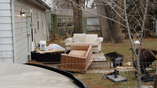 Fort Collins code compliance officers took this image of a backyard littered with couches and discarded items in 2007. The city council on Tuesday paved the way for code compliance officers to issue citations for violations without giving notice of a violation first.