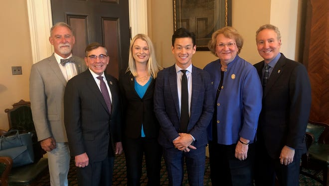 Palm Springs' City Council appears with Assemblymember Evan Low (D-San Jose), the leader of the LGBT Caucus, at the state Capitol in Sacramento