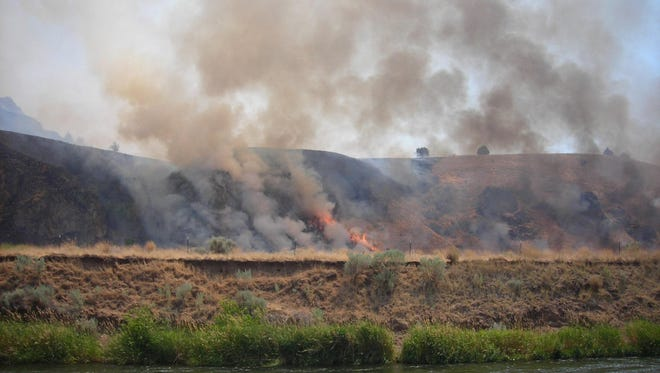 Views of the Boxcar Fire as it burns down along the Deschutes River in Central Oregon.
