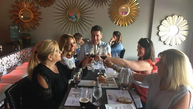 A toast at Cork49 Wine Bar by, from left, Lisa Fiorie, Lisa Gabel, Steve Gabel, Adena Miller and Lynn Hoban.
