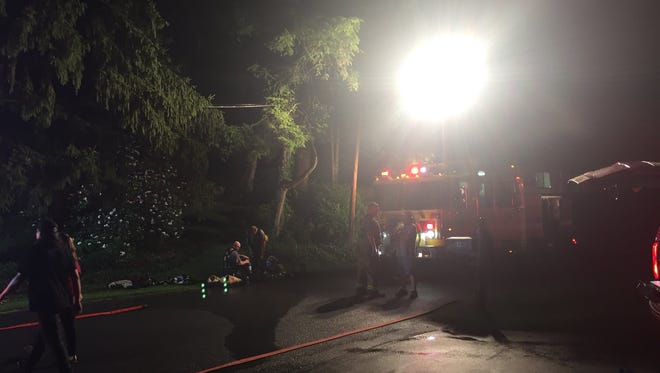 Crews begin to pack up their equipment after putting out a fire on Manor Road in York Township on Wednesday night.