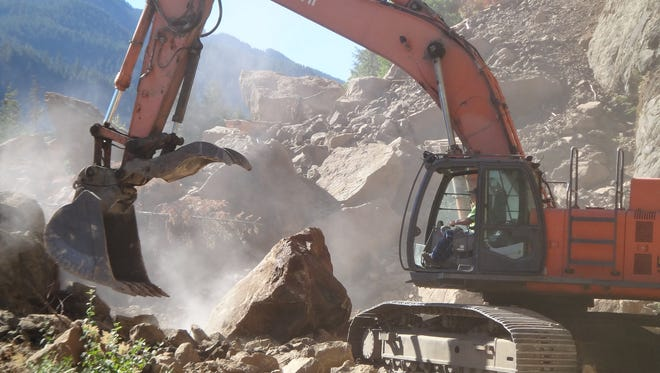 The USDA Forest Service uses heavy equipment to remove huge boulders that blocked Forest Service Road 19 since last December. This is phase 2 of the process with phase 3 opening the road early in August.