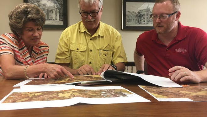Clarksville Mayor Kim McMillan reviews plans for the Northeast Connector road with Jack Frazier, center, and Chris Cowan of the city Street Department.