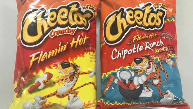 Flaming' Hot Cheetos and Takis tortilla chips are intensely spicy snacks that doctors say are causing abdominal pains in hundreds of Memphis kids.
