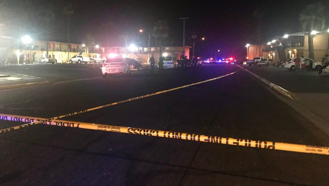 The area near 25th and Van Buren streets was closed Sunday as police searched for a shooter who wounded four people.
