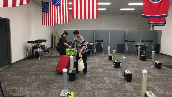 Local Administrator of Elections Elizabeth Black, right, and her senior deputy, Amanda Joslin, prepared for early voting in August. Early voting for the November election begins Wednesday, Oct. 17.