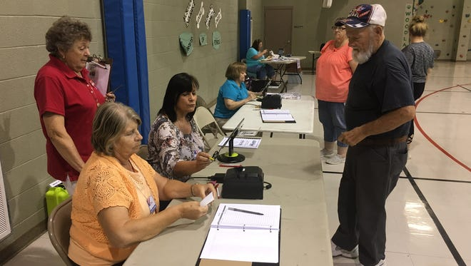 Voters cast their ballots at Woodlawn Elementary School on Aug. 2, 2018.