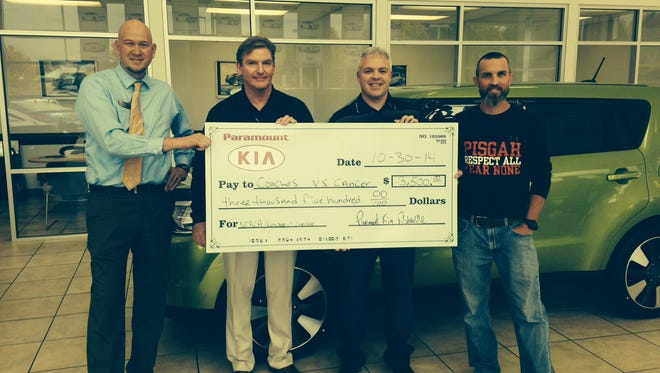 Asheville's Paramount Kia has donated $3,500 to the Coaches vs. Cancer program.