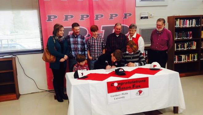 Pisgah senior Mason Fox signed to play college baseball for Gardner-Webb on Wednesday.