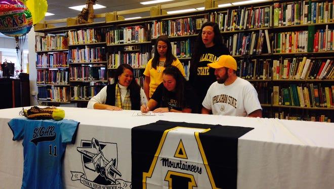 Enka senior Jordan Harris has signed to play college softball for Appalachian State.