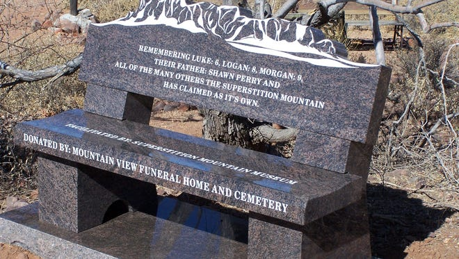 The memorial bench facing the Superstition Mountains.
