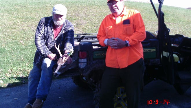 Mike Taylor, left, with his 5-pointer taken during a hunt organized by Challenge the Outdoors. Roger Bricko assisted Taylor on the hunt.