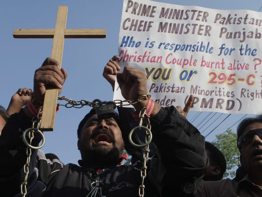 Pakistani Christians chant slogans to condemn the killing