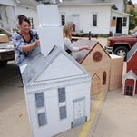 Lisa Hoppes, Holly Clement and Mary Gaiser, left to right, with Michelle Darling (not pictured) work Thursday July 2, 2015 to  build replicas of three Portland churches that were all recently heavily tornado damaged. The replicas are the First Congregational, First Baptist and United Methodist churches, left to right. The replicas will be part of the First Congregational Church's float in the Portland July 4 Parade, held Friday July 3.