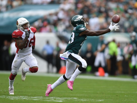 Eagles wide receiver Nelson Agholor catches a ball