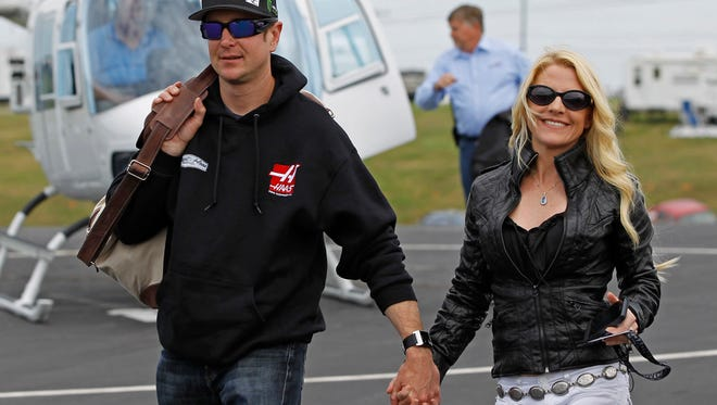 In this May 17, 2014 file photo, Kurt Busch walks with his girlfriend, Patricia Driscoll, after arriving for the NASCAR Sprint All-Star auto race at Charlotte Motor Speedway in Concord, N.C.