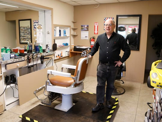 Mark Young of Eastchester, owner of the Buchanan Barber