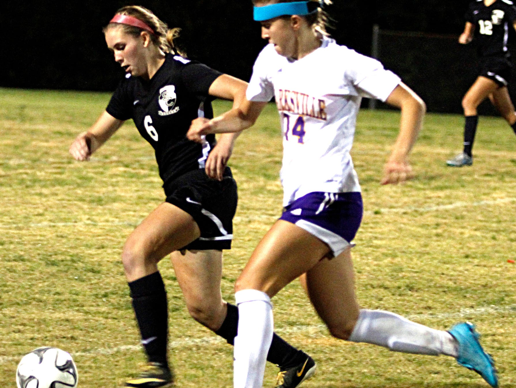 Station Camp High sophomore Victoria Brown battles for possession with Clarksville senior Salera Jordan during the Lady Bison's 2-0 loss in Tuesday evening's Region 5-AAA Tournament semifinal match.