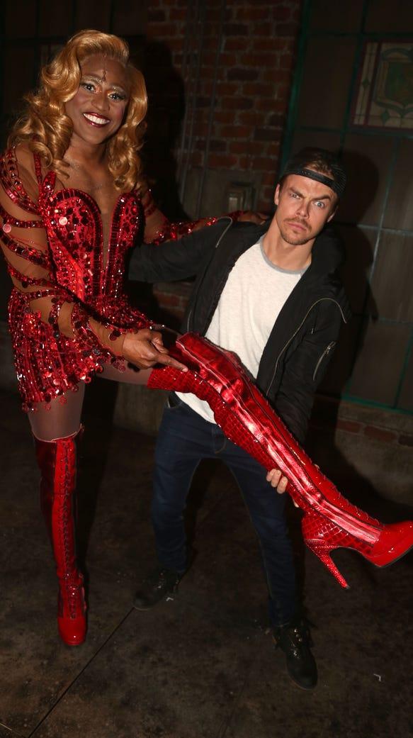 "Wayne Brady as ""Lola"" and Derek Hough pose backstage"