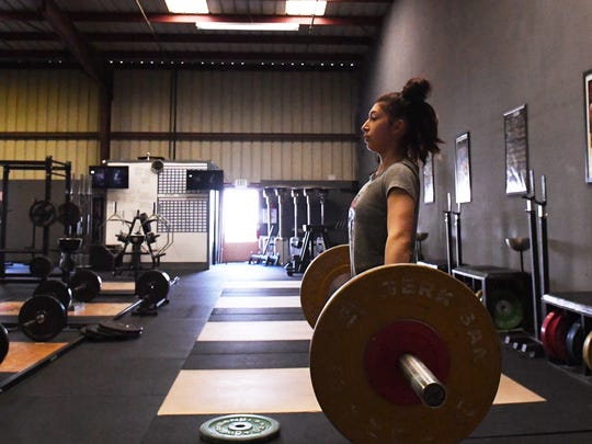 There are two exercises in Olympic weightlifting: the snatch and the clean and jerk. Gama's favorite is the clean and jerk and her max weight (172 pounds) is one of the best in the country in her class.
