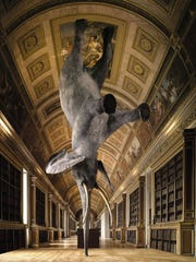 French artist Daniel Firman's 3D piece depicts an elephant performing an impossible trick: standing on its trunk.