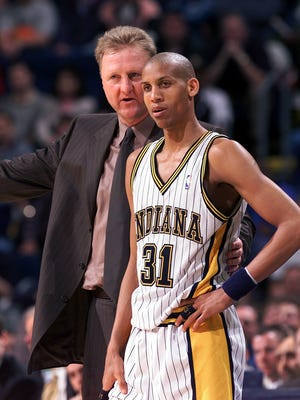 Indiana Pacers coach Larry Bird talks with Reggie Miller  in the second half of their game Wednesday night against Milwaukee at Market Square Arena.