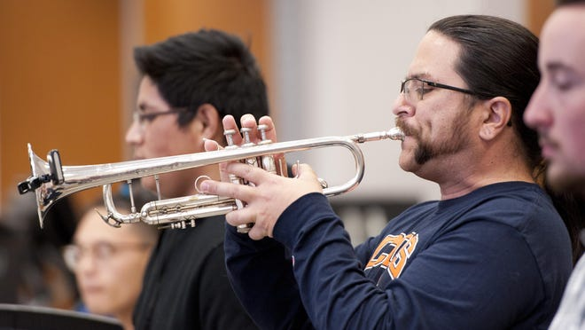 Michael Dewar plays trumpet during rehearsal with the COS Jazz Band on Monday, April 25, 2016. They will perform Wednesday, May 4 with special guests Willie Murillo on trumpet and vocalist Becky Martin. The Sequoia Chamber Chorale will perform May 6 and 7 with special guests and the COS Symphonic Band.