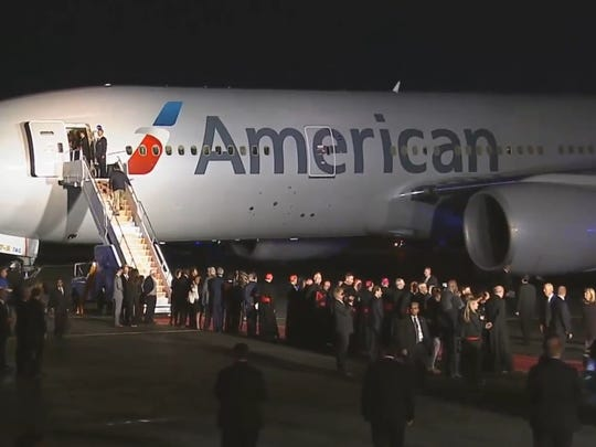 Officials wait for Pope Francis to arrive on the tarmac at Philadelphia International Airport