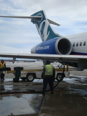 Workers refuel an AirTran Airways aircraft at Milwaukee's General Mitchell Airport on February, 2010.