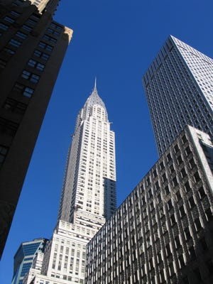 The Chrysler Building stands above other skyscrapers in New York City, now more affordable for Americans.