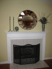 Remove personal items from mantels when you put home up for sale.