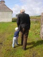 """Austin, age 2, with his grandfather, """"Big Tom,"""" in 2008, on the boy's first trip back to Ireland after he was adopted by U.S. relatives two years earlier"""
